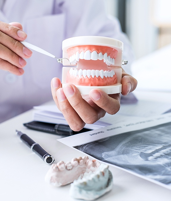 Dentist showing dental patient a smile model during treatment planning